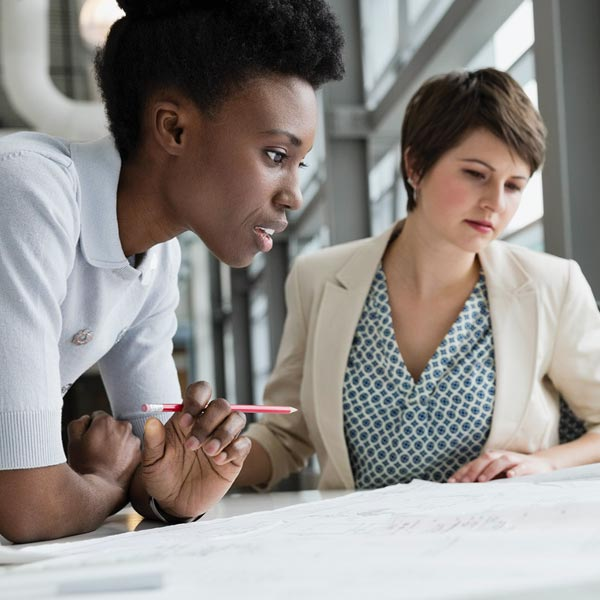 Qlarant Quality Improvement Image - Two Women looking at Plan