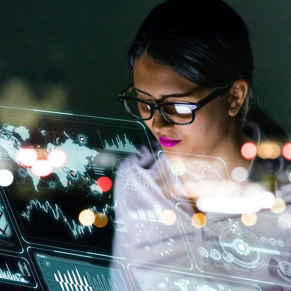 Qlarant Data Science & Technology Image - Woman looking at digital display