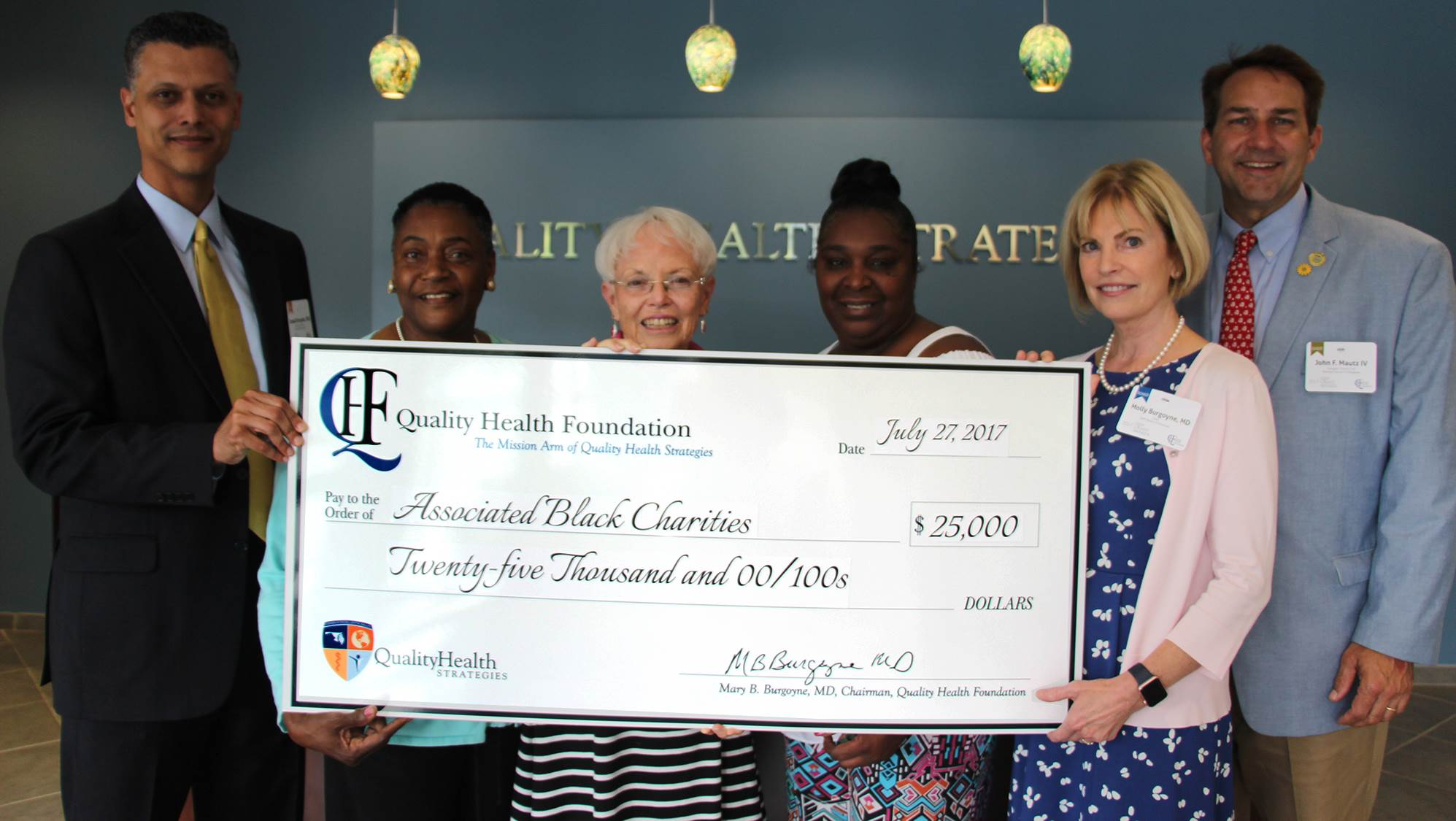 Associated Black Charities, Inc. group photo with QHF check