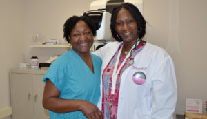 Two female medical providers posing for the camera