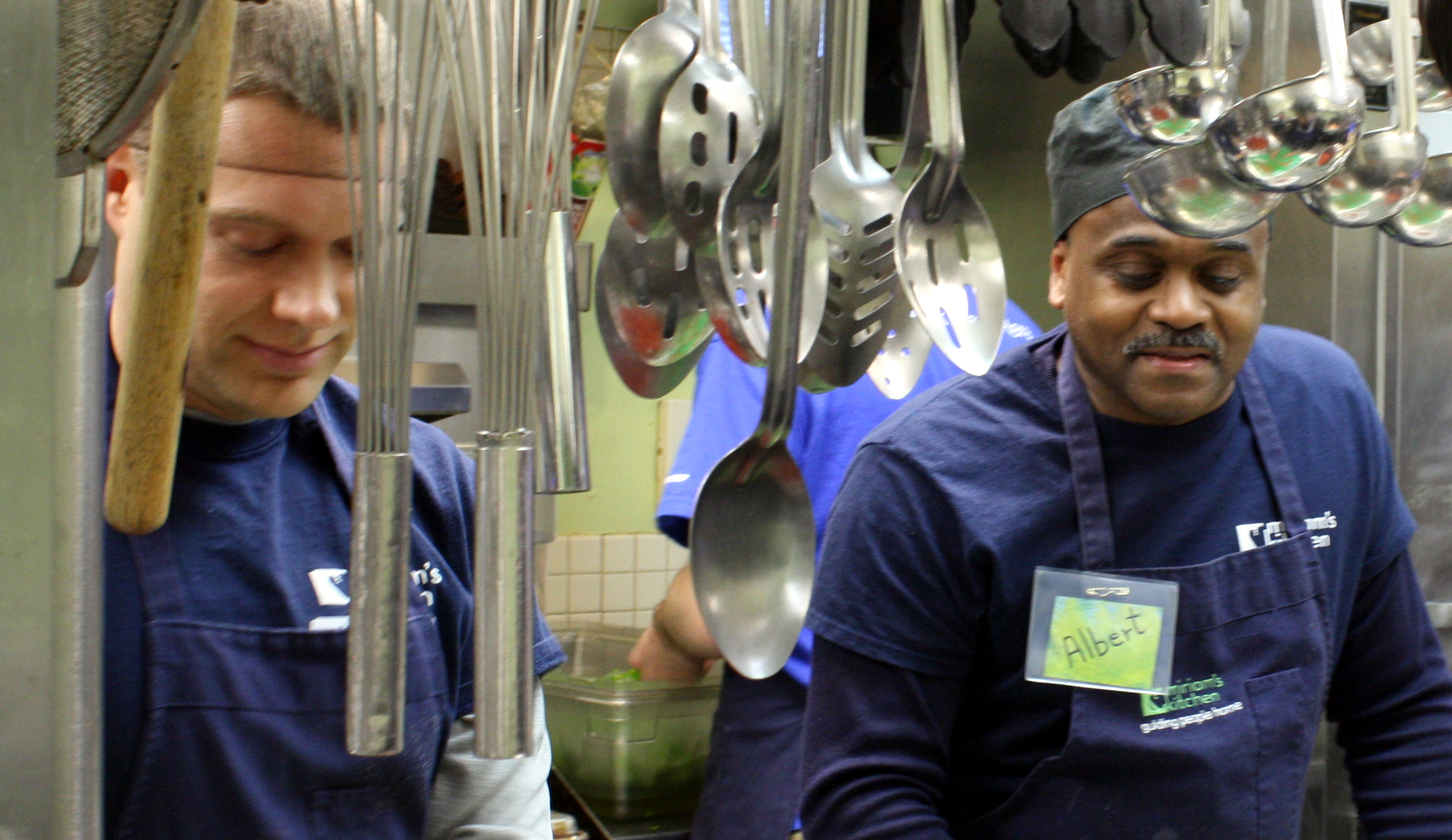 Two men working in a industrial kitchen
