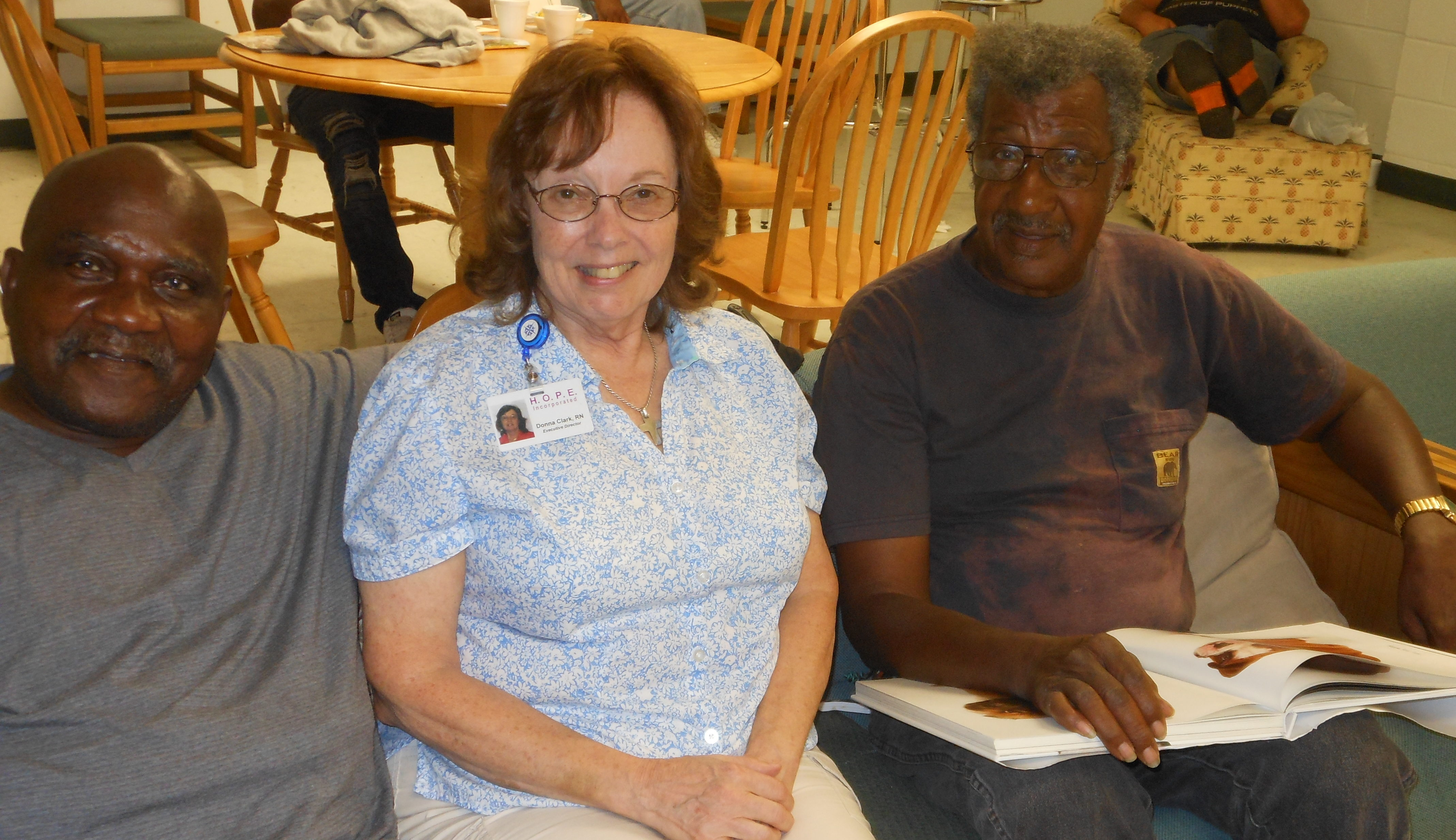 A man and woman on a couch facing the camera