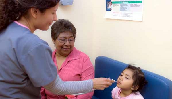 Medical provider taking a child's temperature