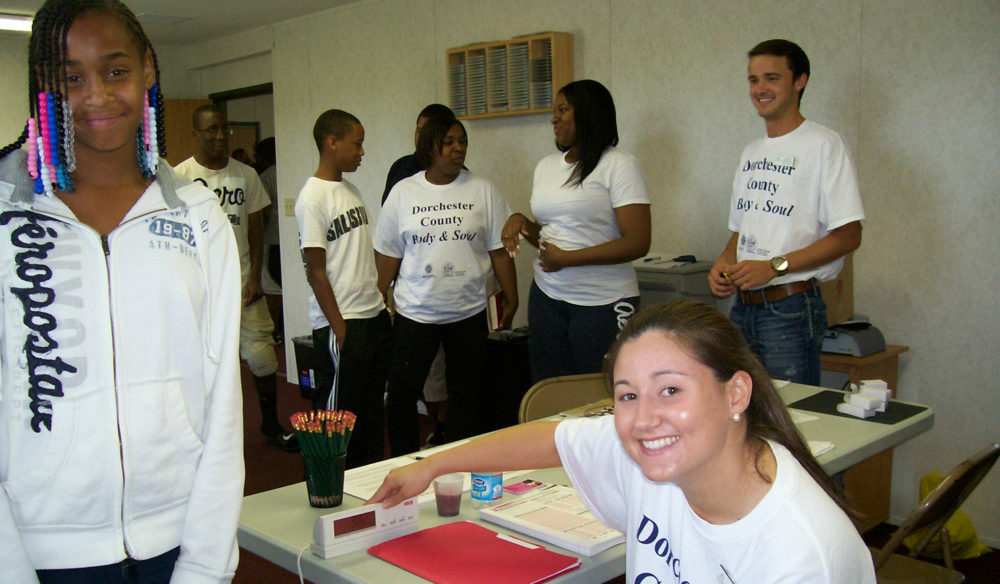 Volunteers working at an event at a table
