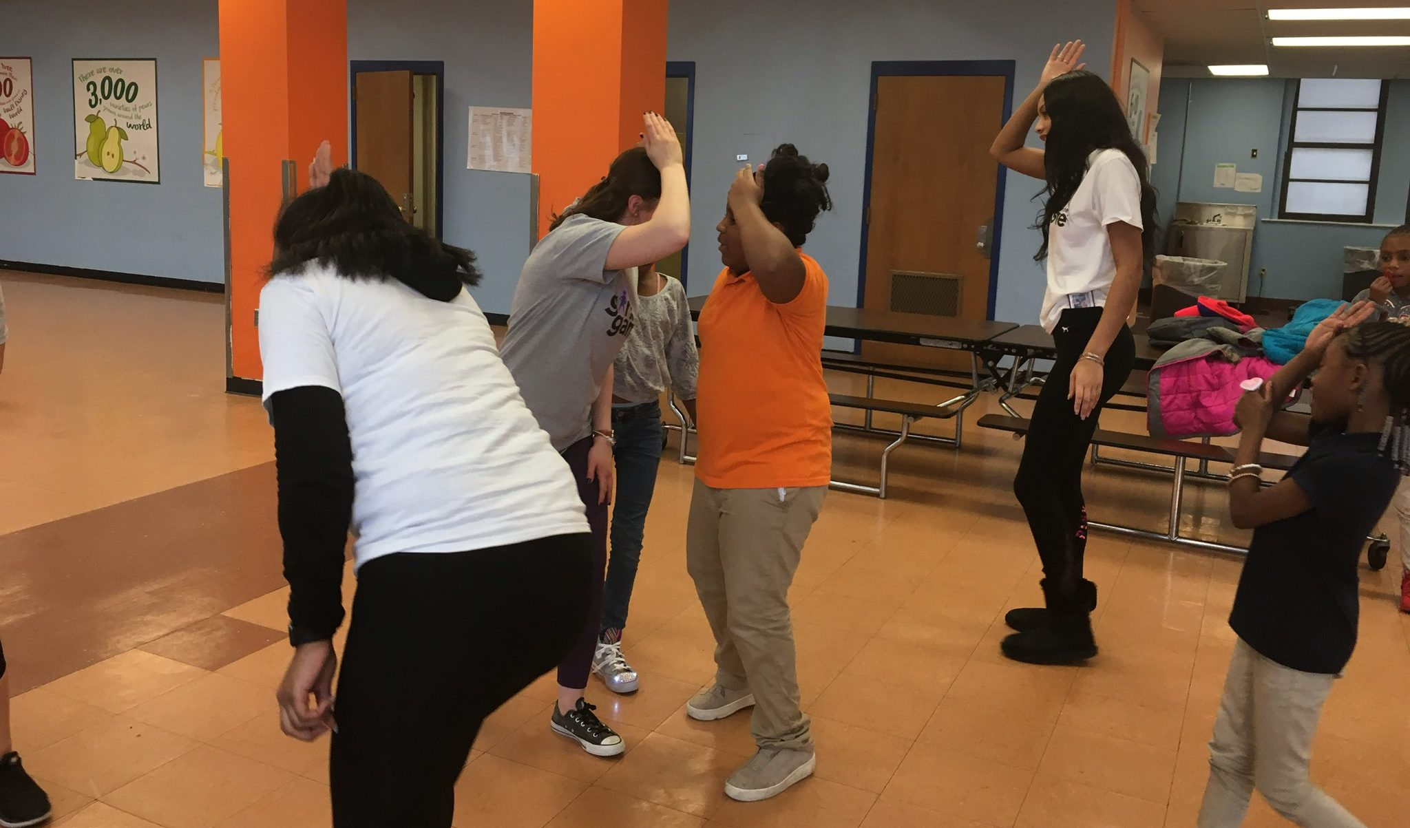 A group of girls dancing