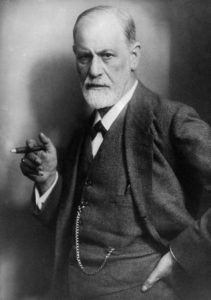 A portrait of Sigmund Freud holding a cigar