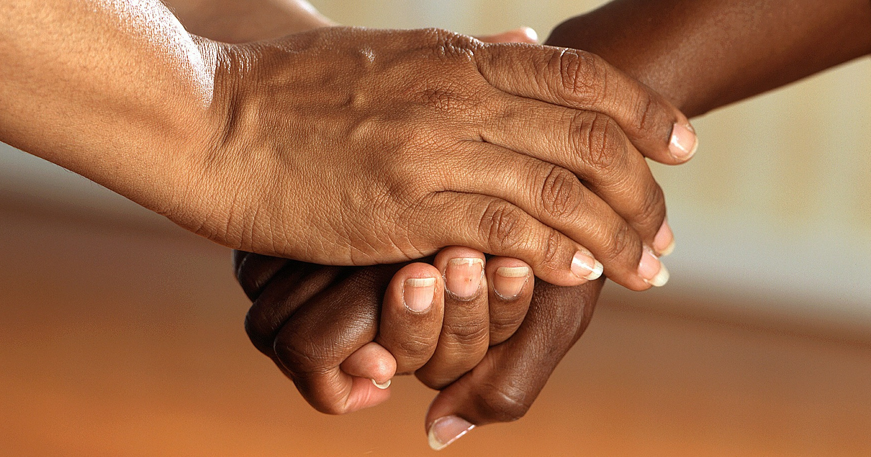two people's hands clasped