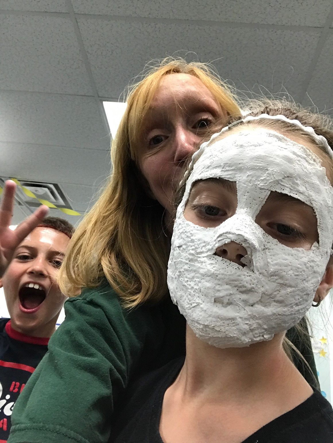 a child with a plaster mask on