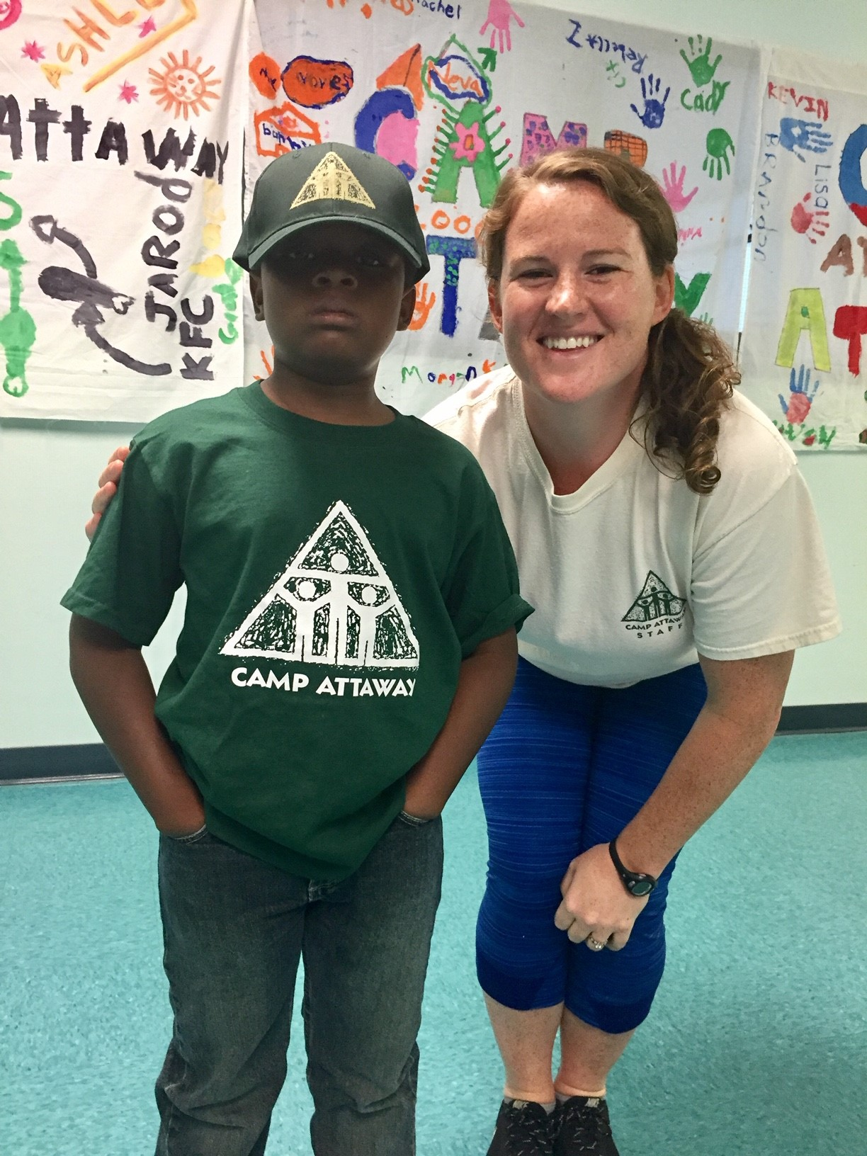 a child posing with a counselor