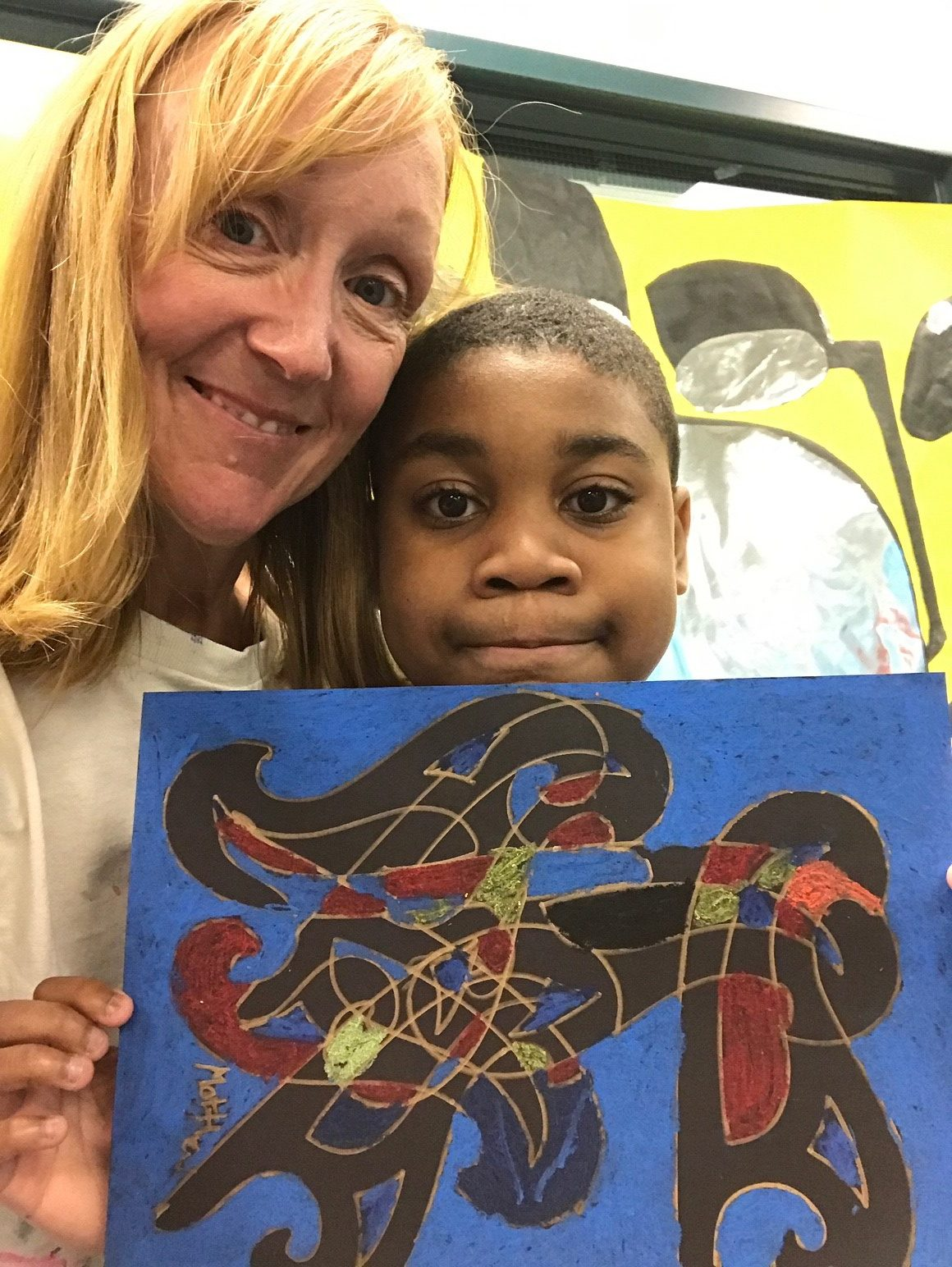 a child and counselor display art