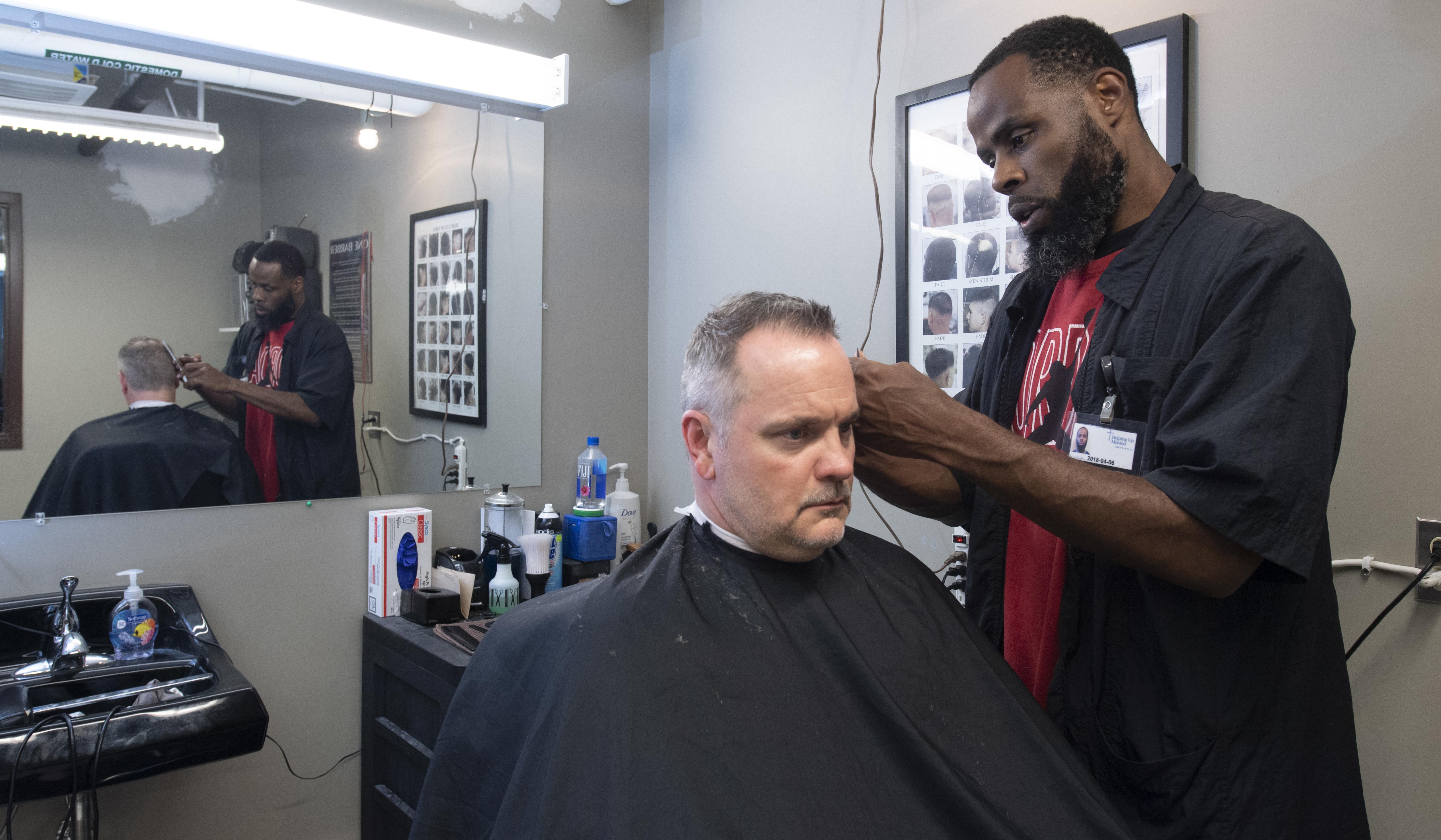 a man getting a haircut