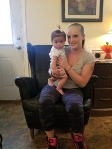 Nikki holding baby Alahni