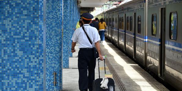 train conductor on platform