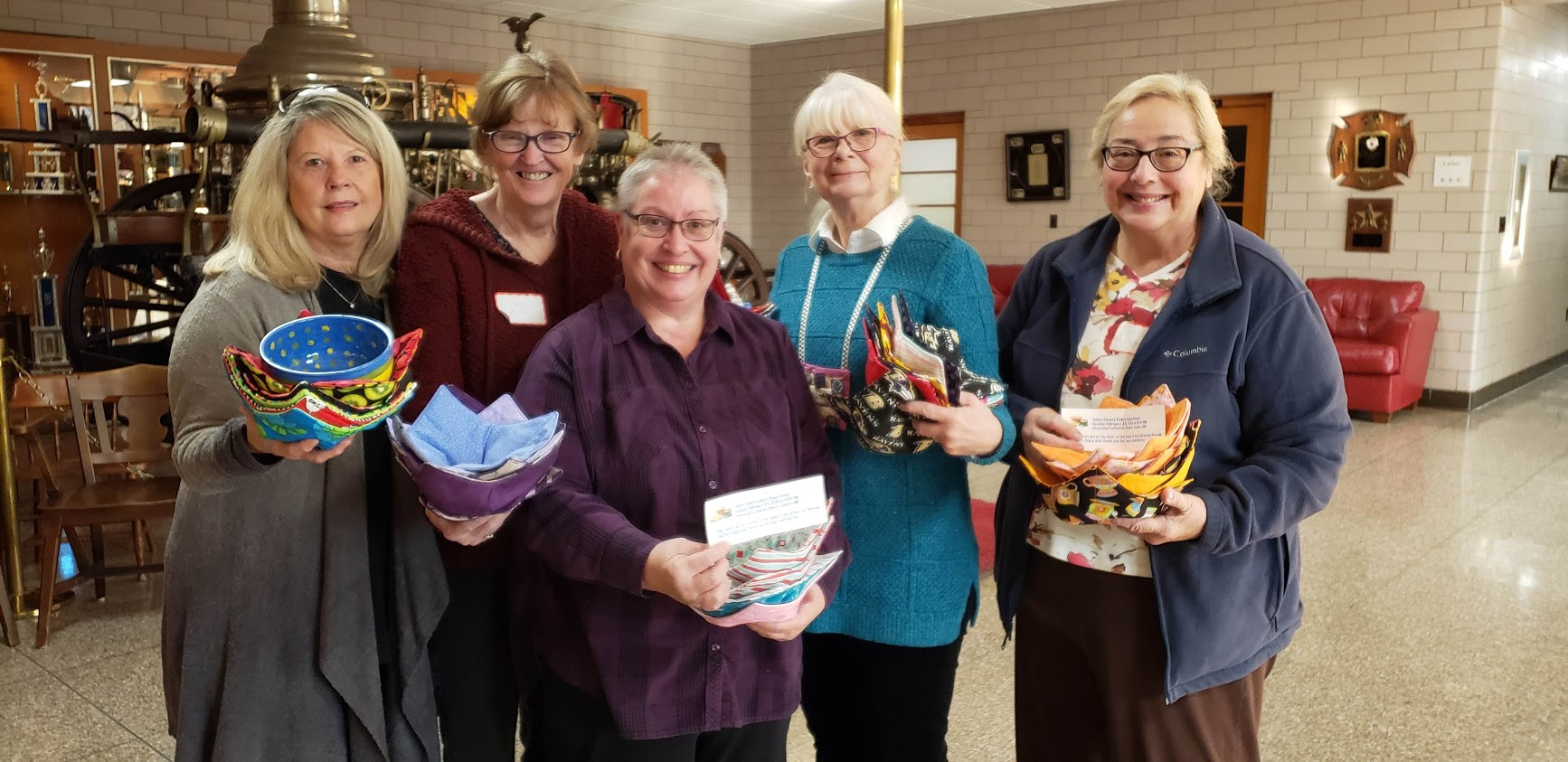 a group of middle aged women holding bowls