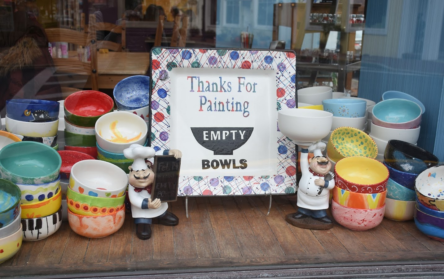 A thank you sign surrounded by ceramics