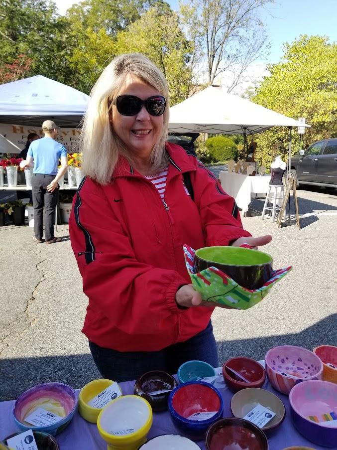 Debbie Brobst holding a bowl