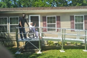 Bay Hundred ramp on a home with homeowner waving