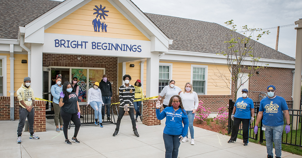 Group of workers standing in front of Bright Beginnings building